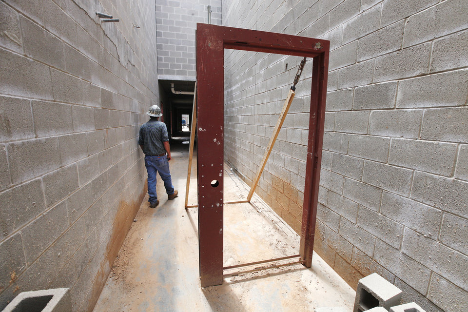 Photo - The construction site shows a security door that will lead to the exercise yard at the Canadian County jail. An addition to the jail is being built in El Reno.  Photo by Paul B. Southerland, The Oklahoman  PAUL B. SOUTHERLAND