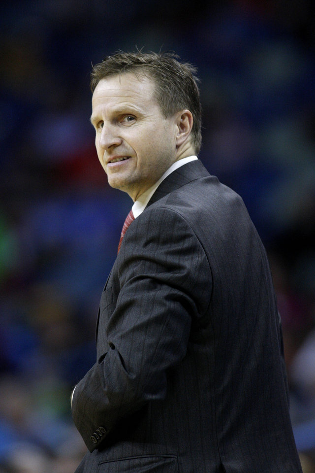 Oklahoma City Thunder head coach Scott Brooks looks on during the first half of an NBA basketball game against the New Orleans Hornets in New Orleans, Friday, Nov. 16, 2012. (AP Photo/Jonathan Bachman) ORG XMIT: LAJB112