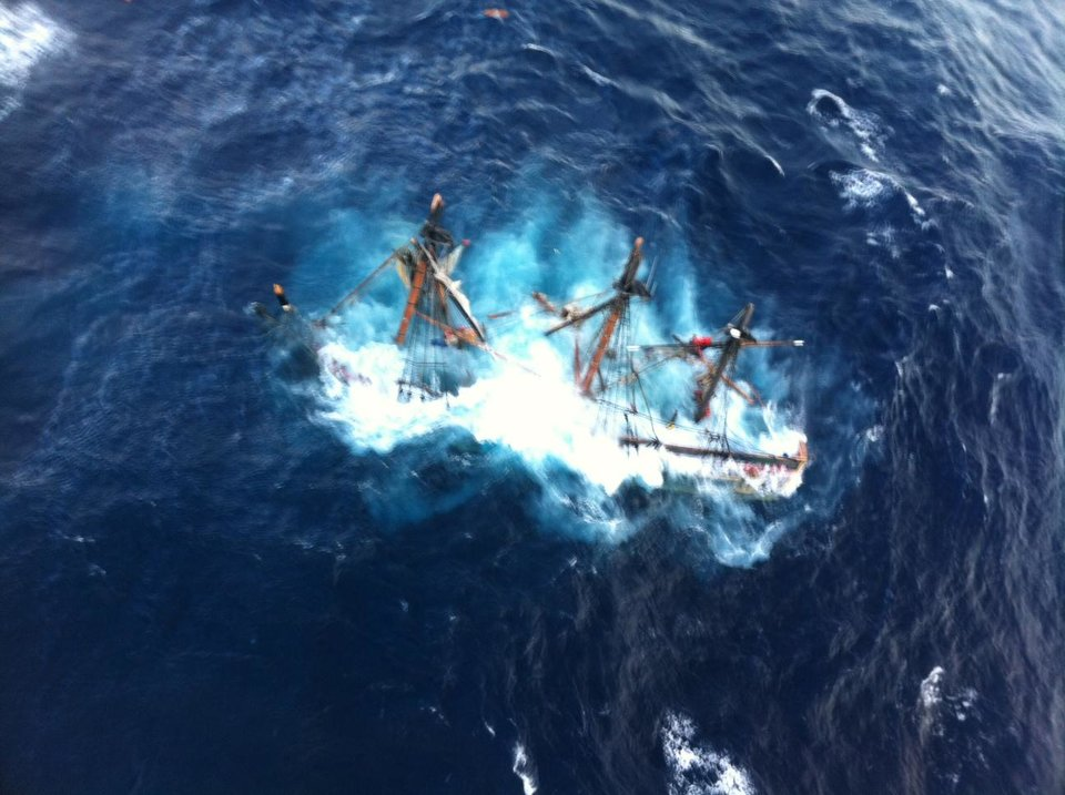 Photo -   This photo provided by the U.S. Coast Guard shows the HMS Bounty, a 180-foot sailboat, submerged in the Atlantic Ocean during Hurricane Sandy approximately 90 miles southeast of Hatteras, N.C., Monday, Oct. 29, 2012. The Coast Guard rescued 14 of the 16 crew members by helicopter. Hours later, rescuers found one of the missing crew members, but she was unresponsive. They are still searching for the captain. (AP Photo/U.S. Coast Guard, Petty Officer 2nd Class Tim Kuklewski)