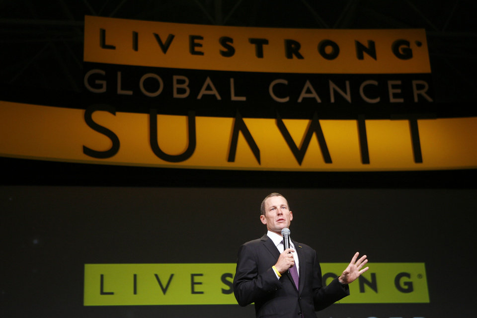 FILE - In this Aug. 24, 2009 file photo, Lance Armstrong speaks at the opening session of the Livestrong Global Cancer Summit in Dublin, Ireland. The president of a cancer charity founded by Armstrong insists that the organization will persevere in the wake of the cyclist's admission that he used performance-enhancing drugs.  (AP Photo/Peter Morrison, File)