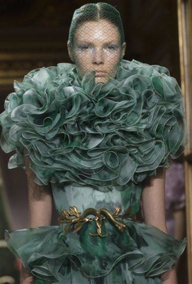 Photo - A model wears a creation by Italian designer Giambattista Valli as part of his presentation for Women's Fall Winter 2013 haute couture fashion collection, for the fashion house in Paris, France, Monday, July 2, 2012. (AP Photo/Jacques Brinon)
