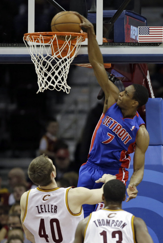 Detroit Pistons\' Brandon Knight (7) dunks over Cleveland Cavaliers\' Tyler Zeller (40) and Tristan Thompson (13) in the second quarter of an NBA basketball game on Wednesday, April 10, 2013, in Cleveland. (AP Photo/Mark Duncan)