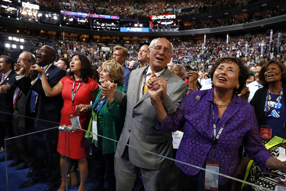 "Photo - Rep. Nita Lowey, D-NY., right, Rep. Paul Tonko, D-N.Y., Rep. Louise Slaughter, D-N.Y., and other delegates sing along as entertainers sing ""What the World Needs Now"" during the third day session of the Democratic National Convention in Philadelphia, Wednesday, July 27, 2016. (AP Photo/Carolyn Kaster)"