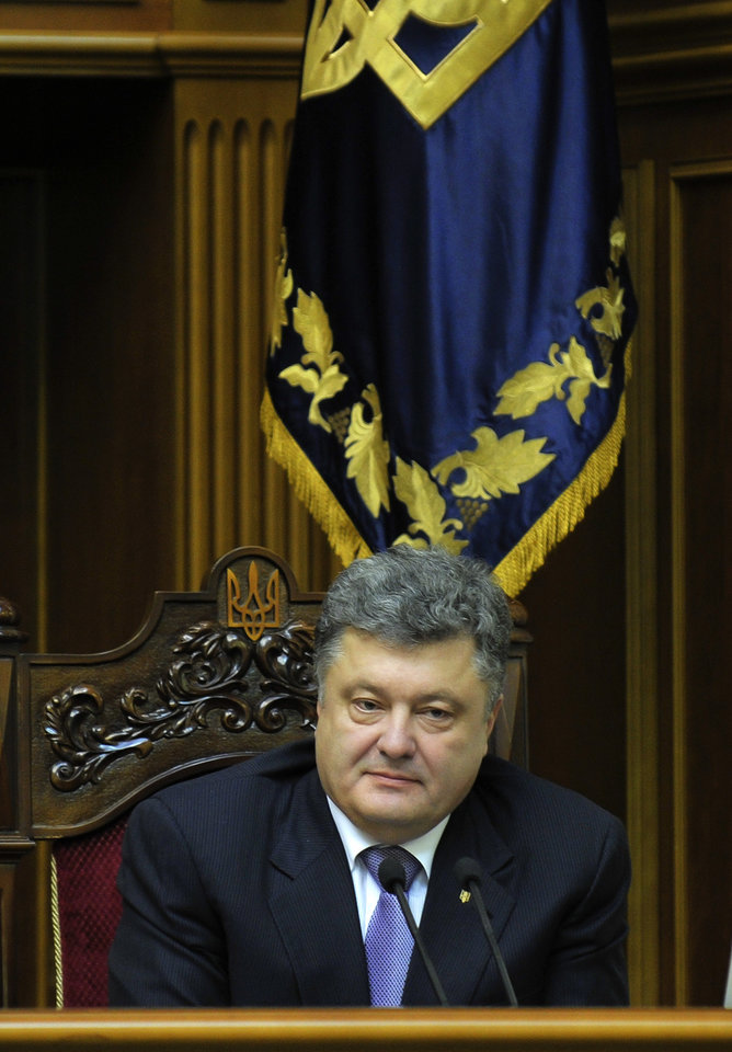 Photo - Ukrainian President Petro Poroshenko, speaks to lawmakers during a session of the parliament in Kiev, Ukraine, Thursday, June 19, 2014. The Ukrainian parliament on Thursday approved Ukraine's new foreign minister, prosecutor-general and National Bank Chief(AP Photo/Mykola Lazarenko, pool)
