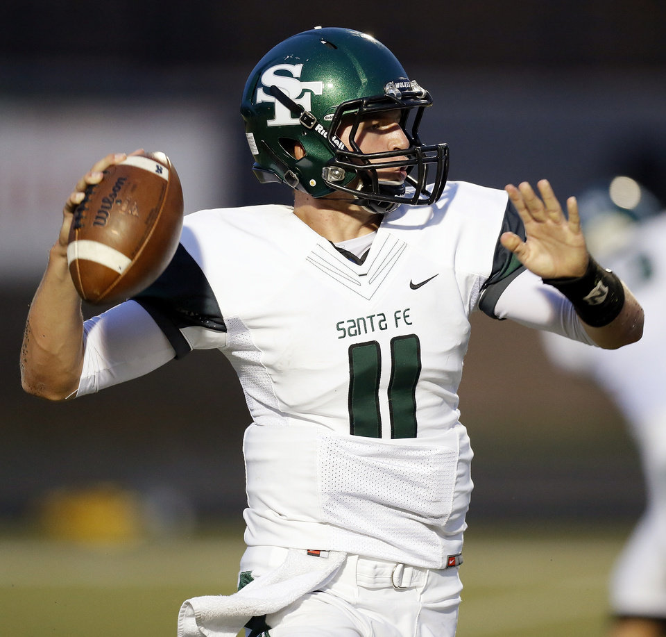 Photo - Edmond Santa Fe's Justice Hansen (11) passes during a high school football game between Mustang and Edmond Santa Fe in Mustang, Okla., Friday, Sept. 28, 2012. Photo by Nate Billings, The Oklahoman