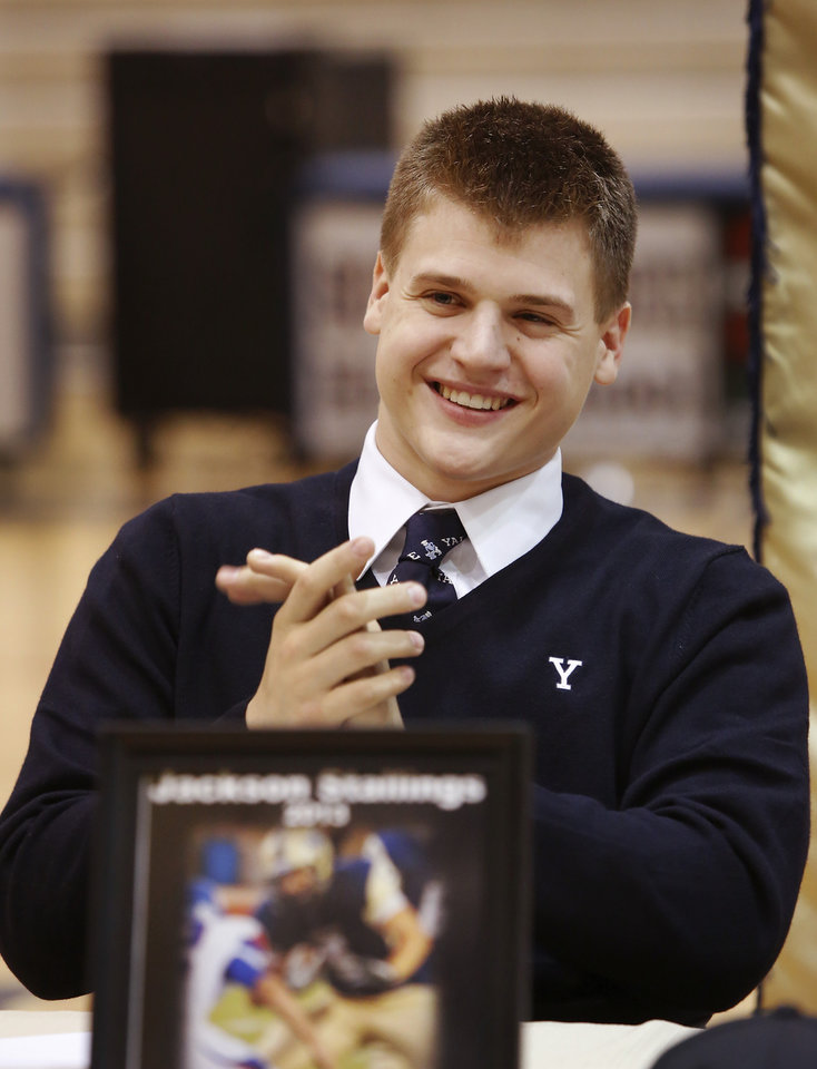 Jackson Stallings claps for fellow athletes as they sign their letters. Stallings will attend Yale. More than a dozen Southmoore High School athletes signed letters of intent to play at various colleges and universities during an afternoon signing ceremony in the school\'s gymnasium on Wednesday, Feb. 6, 2013. Photo by Jim Beckel, The Oklahoman