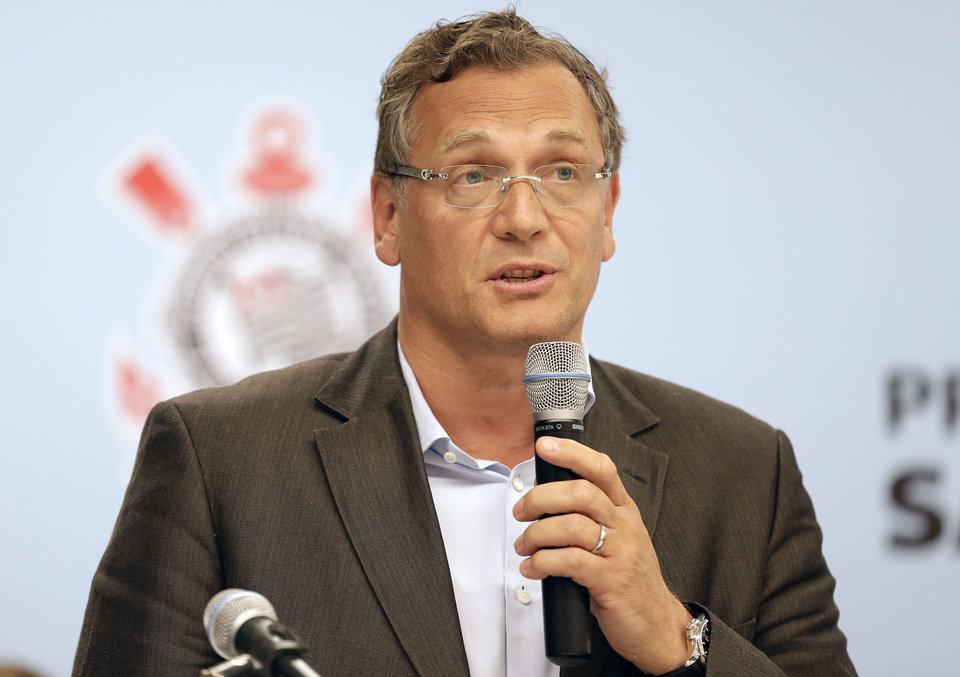 Photo - FIFA Secretary General Jerome Valcke speaks during a news conference after inspecting the unfinished Itaquerao stadium in Sao Paulo, Brazil, Tuesday, April 22, 2014. The stadium will host the World Cup opener match between Brazil and Croatia in June. (AP Photo/Andre Penner)