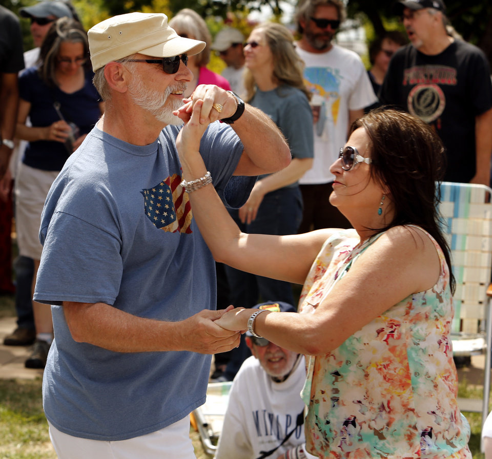 Photo - Randy and Gaila Alexander dance near the Sailor Jerry Stage during the Norman Music Festival on Saturday, April 26, 2014 in Norman, Okla.  Photo by Steve Sisney, The Oklahoman