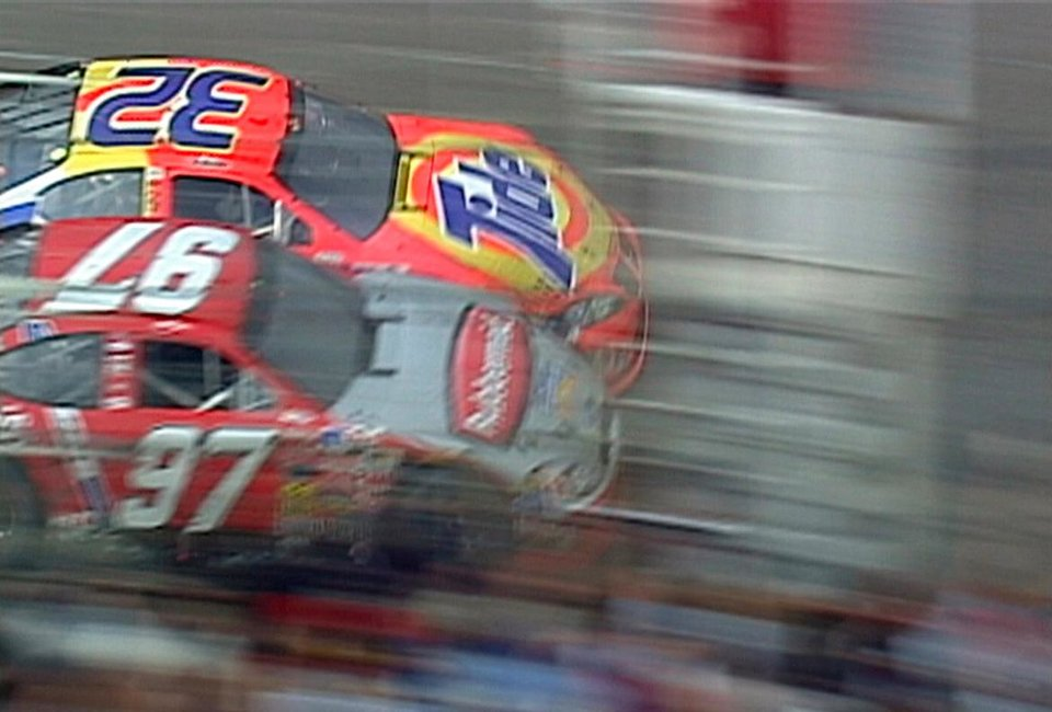 Photo - FILE - In this March 16, 2003 image that was retrieved from the NASCAR scoring camera positioned at the start/finish line, Ricky Craven (32) beats Kurt Busch by .002 seconds to win the Carolina Dodge Dealers 400 auto race at Darlington Raceway in Darlington, S.C. It was 10 years ago that Busch came up an agonizing .002 seconds shy of victory to Ricky Craven at the track