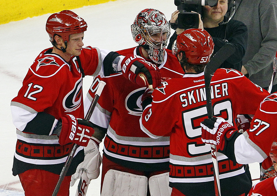Carolina Hurricanes' Eric Staal (12) celebrates with teammates Cam Ward (30) and Jeff Skinner (53) following their win over the Buffalo Sabres in Raleigh, N.C., Thursday, Jan. 24, 2013. Staal had three goals and Skinner added two in the 6-3 win. (AP Photo/Karl B DeBlaker)