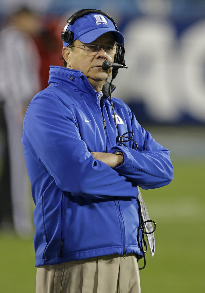 Duke head coach David Cutliffe looks on from the sidelines in the second half of the Atlantic Coast Conference Championship NCAA football game against Florida State in Charlotte, N.C., Saturday, Dec. 7, 2013. (AP Photo/Bob Leverone)
