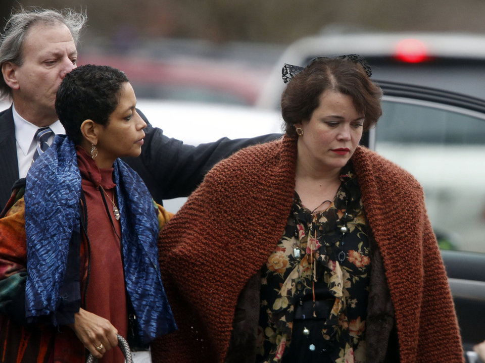 Photo - Veronique Pozner, right, arrives at a funeral service for her son, 6-year-old Noah Pozner, Monday, Dec. 17, 2012, in Fairfield, Conn. Noah Pozner was killed when Adam Lanza walked into Sandy Hook Elementary School in Newtown Friday and opened fire, killing 26 people, including 20 children. (AP Photo/Jason DeCrow)