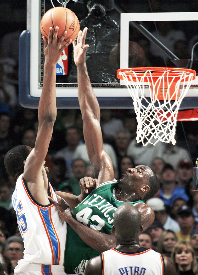Boston's Kendrick Perkins, right, blocks the shot of Oklahoma City's Kevin Durant in the second half of the Thunder's 96-83 loss to the Celtics on Wednesday at the Ford Center. Durant led the Thunder with 17 points. PHOTO BY NATE BILLINGS, THE OKLAHOMAN