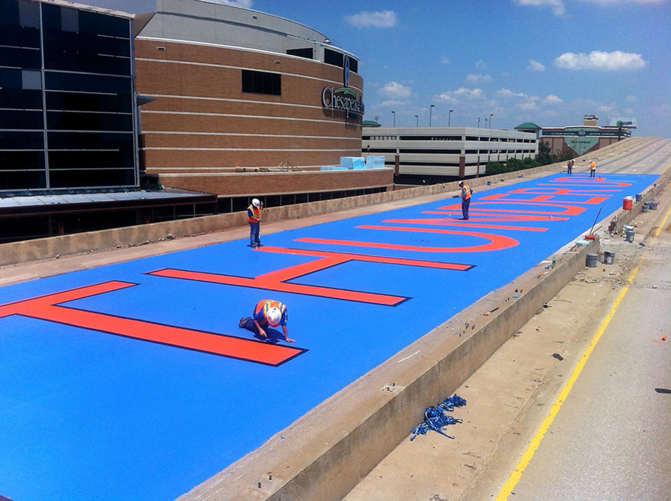 "Sherwood Construction, the demolition company working on the old I-40, wanted to show their support for the Thunder.  They painted ""Thunder Up"" in 23' tall letters on the bridge deck just south of the arena."