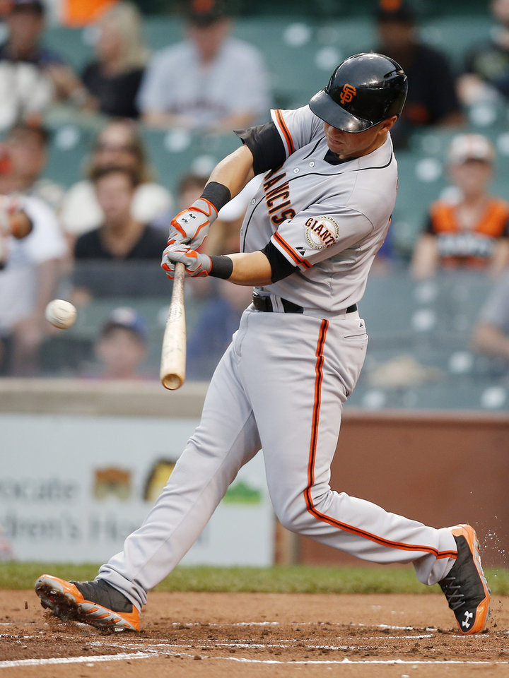 Photo - San Francisco Giants' Joe Panik hits an RBI-single against the Chicago Cubs during the sixth inning of the continuation of a baseball game that began Tuesday, on Thursday, Aug. 21, 2014, in Chicago. Tuesday's game was suspended in the fifth inning due to rain. (AP Photo/Andrew A. Nelles)