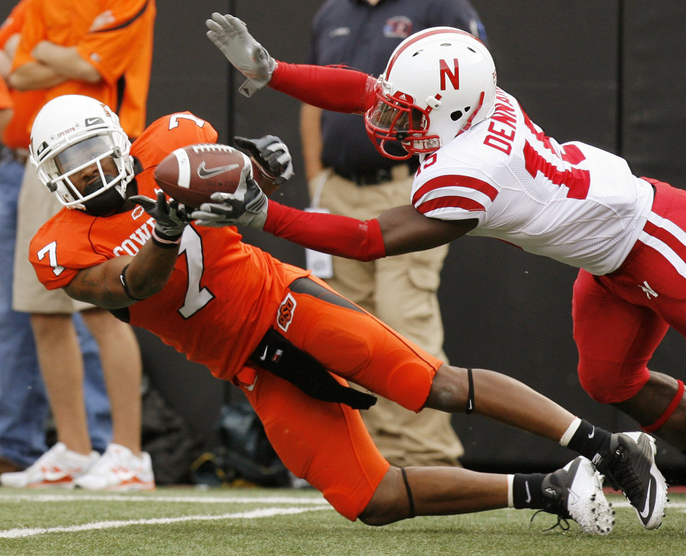 Photo - Nebraska's Alfonzo Dennard (15) breaks up a pass intended for Michael Harrison (7) of OSU in the third quarter during the college football game between the Oklahoma State Cowboys (OSU) and the Nebraska Huskers (NU) at Boone Pickens Stadium in Stillwater, Okla., Saturday, Oct. 23, 2010. Nebraska won, 51-41. Photo by Nate Billings, The Oklahoman