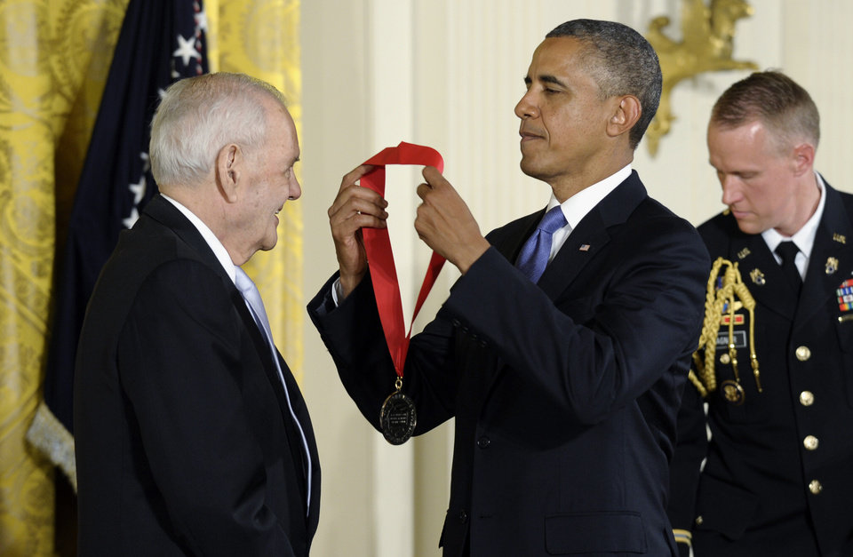 Photo - President Barack Obama presents Robert B. Silvers, editor and co-founder of The New York Review of Books, with the 2012 National Humanities Medal during a ceremony in the East Room of White House in Washington, Wednesday, July 10, 2013. (AP Photo/Susan Walsh)