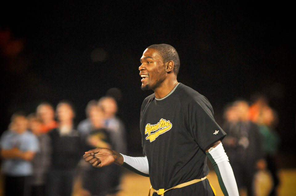 Photo - Kevin Durant plays in an intramural flag football game with Sigma Nu fraternity at Oklahoma State University, Oct. 31, 2011. Photo by KT King, with permission. (@shuttrking)