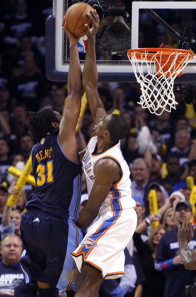 Photo - Oklahoma City's Serge Ibaka (9) blocks Denver's Nene's (31) shot in the final minute during the NBA basketball game between the Denver Nuggets and the Oklahoma City Thunder in the first round of the NBA playoffs at the Oklahoma City Arena, Wednesday, April 27, 2011. Photo by Sarah Phipps, The Oklahoman