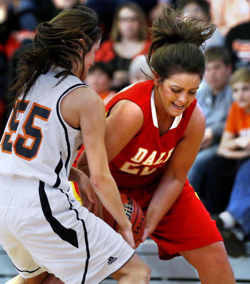 Photo - Dale's Lexes Satterwhite battles for the ball as the Tonkawa Lady Bucs play the Dale Lady Pirates in class 2A State Playoff girls basketball at Westmoore High School on Thursday, March 7, 2013, in Moore, Okla. Photo by Steve Sisney, The Oklahoman