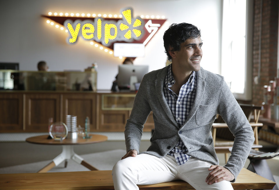 Photo - In this photo taken Friday, Aug. 1, 2014, Yelp CEO Jeremy Stoppelman poses at his company's headquarters in San Francisco. Stoppelman, 36, probably wouldn't be running Yelp Inc. if he had paid more attention to the opinions of outsiders than his own insights. (AP Photo/Eric Risberg)