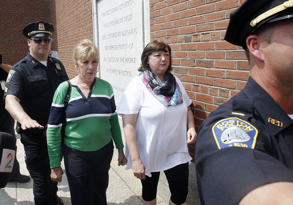 Photo - Boston police escort Liz Norden, right, mother of wounded Boston Marathon bombing survivor J.P. Norden, of Stoneham, Mass., to the federal courthouse prior to arraignment for bombing suspect Dzhokhar Tsarnaev Wednesday, July 10, 2013, in Boston. The woman at left is unidentified. The April 15 attack killed three and wounded more than 260. The 19-year-old Tsarnaev has been charged with using a weapon of mass destruction, and could face the death penalty. (AP Photo/Winslow Townson)