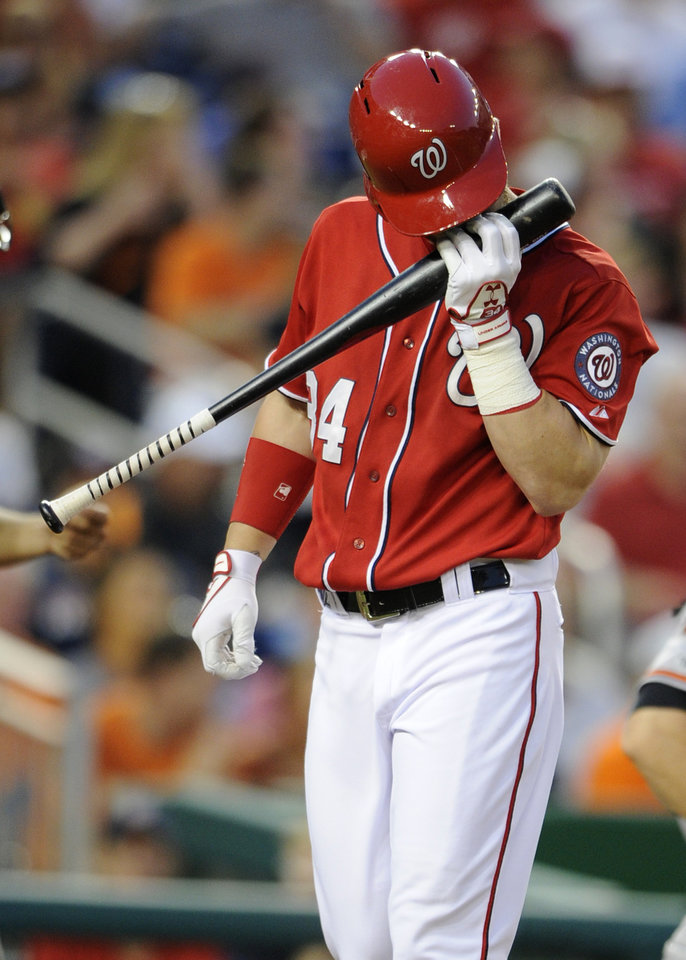 Photo - Washington Nationals' Bryce Harper pauses during his at bat during the fourth inning of a baseball game against the Baltimore Orioles, Monday, Aug. 4, 2014, in Washington. (AP Photo/Nick Wass)