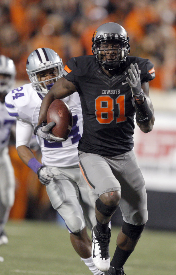 Oklahoma State\'s Justin Blackmon (81) runs up field as Kansas State\'s Nigel Malone (24) chases him during a college football game between the Oklahoma State University Cowboys (OSU) and the Kansas State University Wildcats (KSU) at Boone Pickens Stadium in Stillwater, Okla., Saturday, Nov. 5, 2011. Photo by Sarah Phipps, The Oklahoman