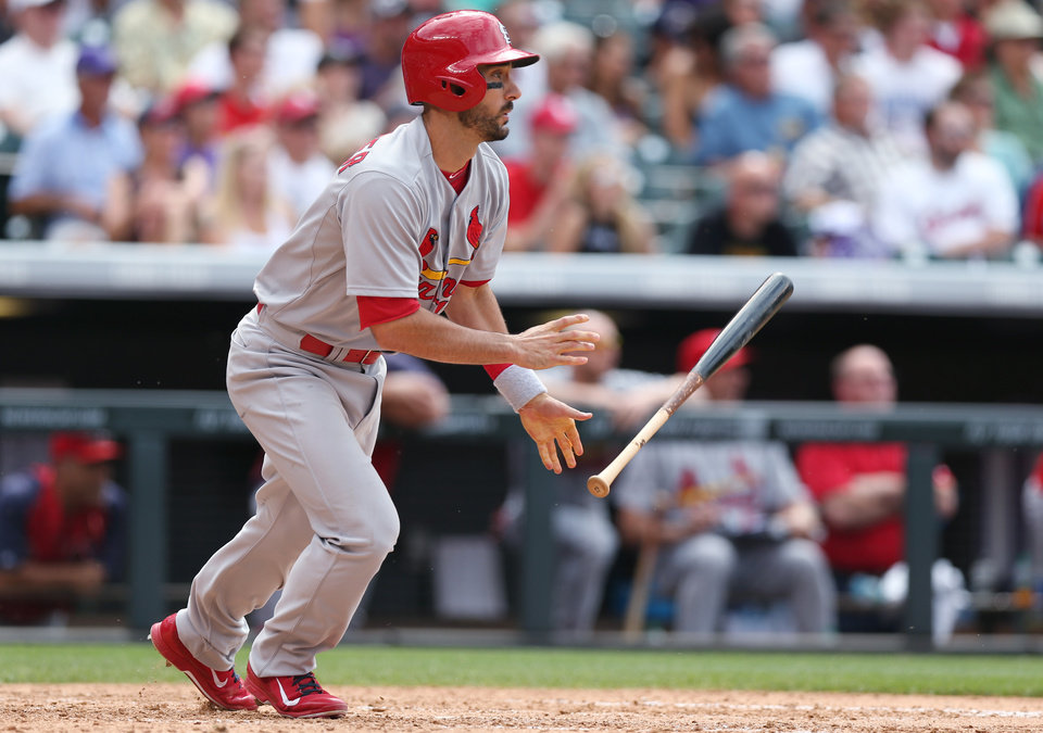 Photo - St. Louis Cardinals' Matt Carpenter follows the flight of his RBI-double to drive in the go-ahead run against the Colorado Rockies in the eighth inning of the Cardinals' 9-6 victory in a baseball game in Denver on Wednesday, June 25, 2014. (AP Photo/David Zalubowski)
