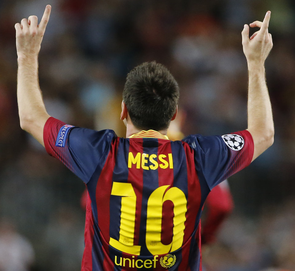 Photo - Barcelona's Lionel Messi celebrates scoring 1-0 during the Champions League group H soccer match between Ajax Amsterdam and F.C. Barcelona on Wednesday, Sept. 18, 2013, at Camp Nou stadium in Barcelona, Spain. (AP Photo/Emilio Morenatti)