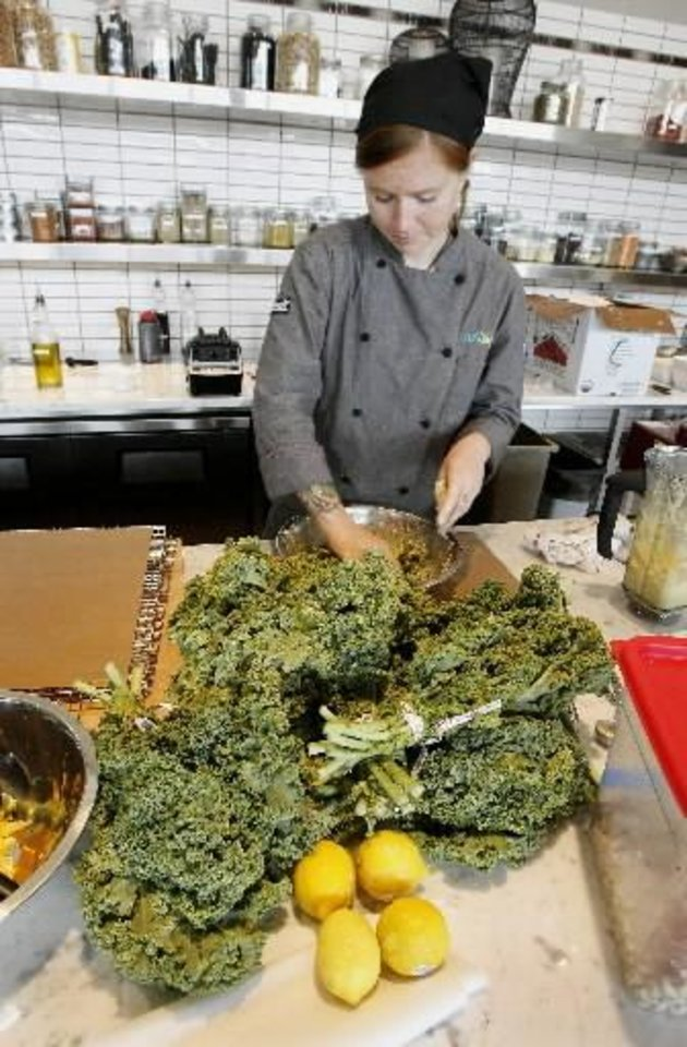 Photo - Chelsea Smith, chef de partie, preparing cheesy kale chips in the kitchen at 105degrees, 5820 N Classen, Suite 1, in Oklahoma City Thursday, Sept. 10, 2009. Photo by Paul B. Southerland, The Oklahoman