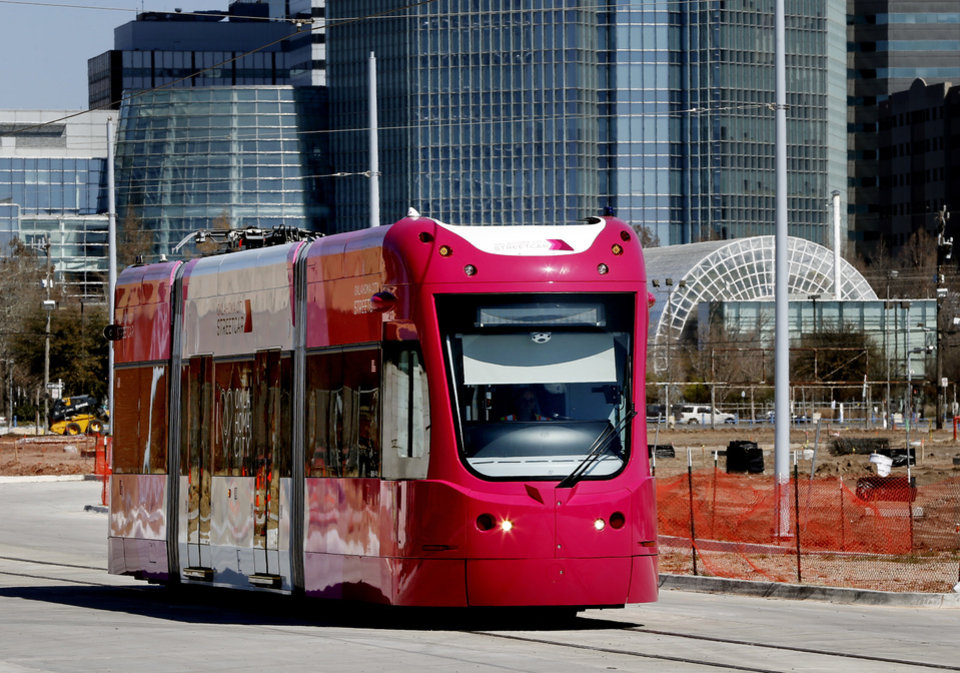 Photo - This is how the streetcar looks with the pantograph retracted. The streetcar system with have overhead wires in Midtown and Bricktown but streetcars will run on batteries through the central business district. [Photo by Steve Sisney, The Oklahoman]