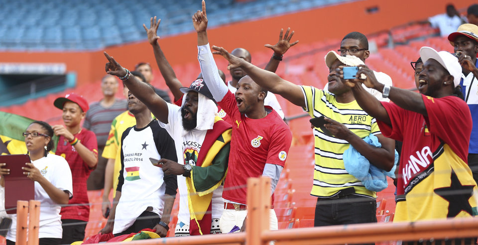Photo - Soccer fans cheer for the Ghana National team as it plays South Korea during the first half of an international  friendly soccer match in Miami Gardens, Fla., Monday, June 9, 2014. ( AP Photo/J Pat Carter)