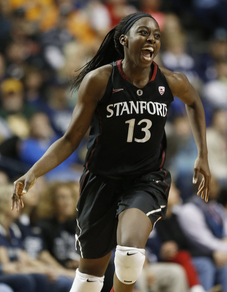 Photo - Stanford forward Chiney Ogwumike (13) celebrates a basket against Connecticut during the second half of the semifinal game in the Final Four of the NCAA women's college basketball tournament, Sunday, April 6, 2014, in Nashville, Tenn. (AP Photo/John Bazemore)