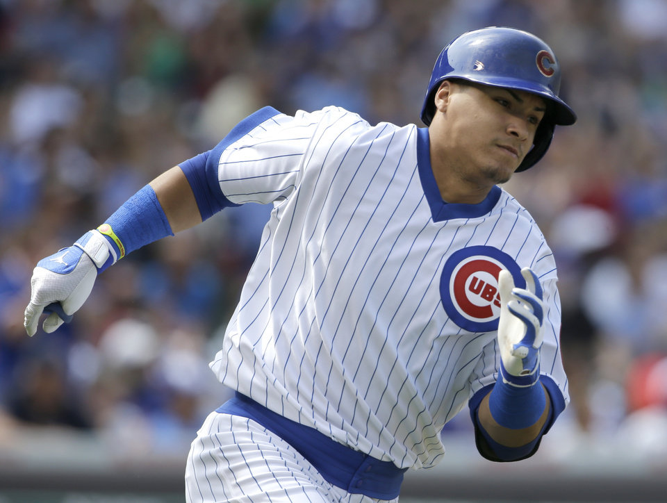 Photo - Chicago Cubs' Javier Baez runs to second base after hitting an one-run single during the fifth inning of an interleague baseball game against the Tampa Bay Rays in Chicago, Sunday, Aug. 10, 2014. (AP Photo/Nam Y. Huh)