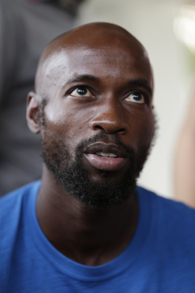 Photo - United States' DaMarcus Beasley talks to reporters during a training session in Sao Paulo, Brazil, Saturday, June 28, 2014. The United States will play Belgium on Tuesday in the round of 16 of the soccer World Cup. (AP Photo/Julio Cortez)