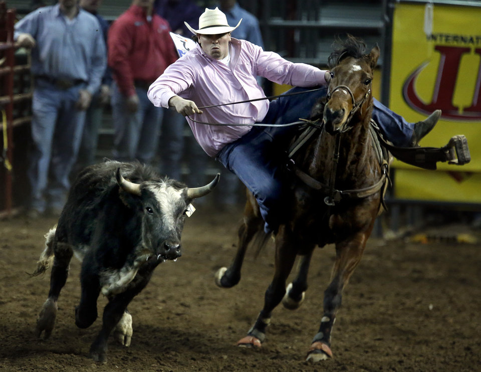 Photo - Cody Mousseau of Aylmer Canada, Ontario, competes in steer wrestling during the International Finals Rodeo at the State Fair Arena in Oklahoma City, Friday, Jan. 17, 2014.  Photo by Sarah Phipps, The Oklahoman