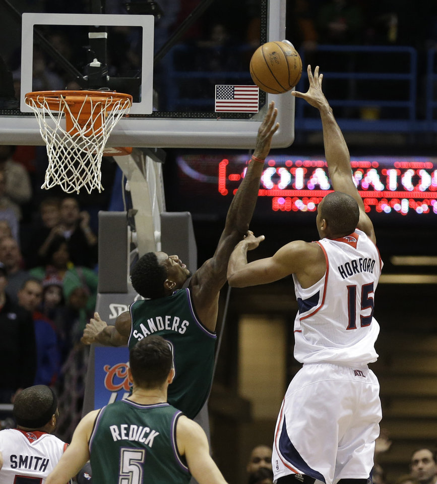 Atlanta Hawks' Al Horford(15) puts up the game-winning shot against Milwaukee Bucks' Larry Sanders during the second half of an NBA basketball game, Saturday, Feb. 23, 2013, in Milwaukee. Atlanta won 103-102. (AP Photo/Jeffrey Phelps)