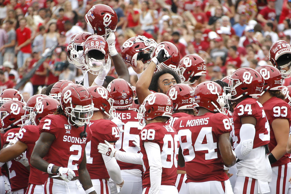 Photo - The Oklahoma football team gathers before a college football game between the University of Oklahoma Sooners (OU) and Texas Tech University at Gaylord Family-Oklahoma Memorial Stadium in Norman, Okla., Saturday, Sept. 28, 2019. [Bryan Terry/The Oklahoman]