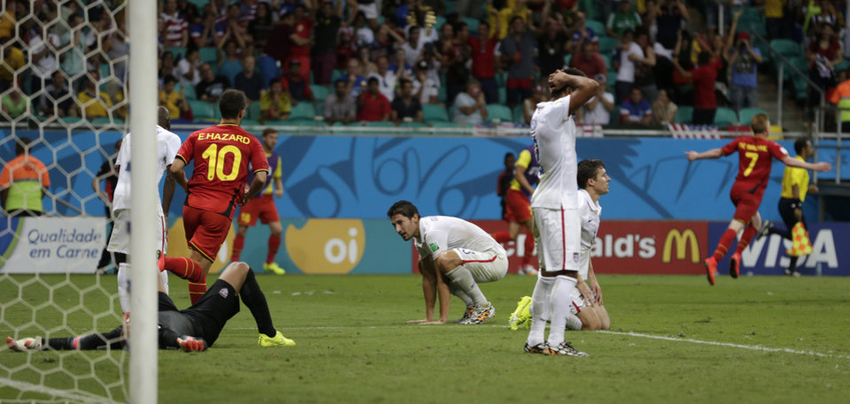 US players react after Belgium's Kevin De Bruyne, right,  scored the opening goal during the World Cup round of 16 soccer match between Belgium and the USA at the Arena Fonte Nova in Salvador, Brazil, Tuesday, July 1, 2014.  (AP Photo/Julio Cortez)