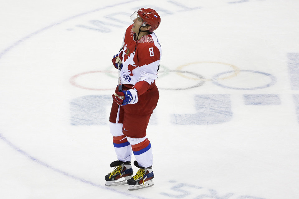 Photo - Russia forward Alexander Ovechkin skates off the ice after the 3-1 loss to Finland in the men's quarterfinal hockey game in Bolshoy Arena at the 2014 Winter Olympics, Wednesday, Feb. 19, 2014, in Sochi, Russia. (AP Photo/David J. Phillip )