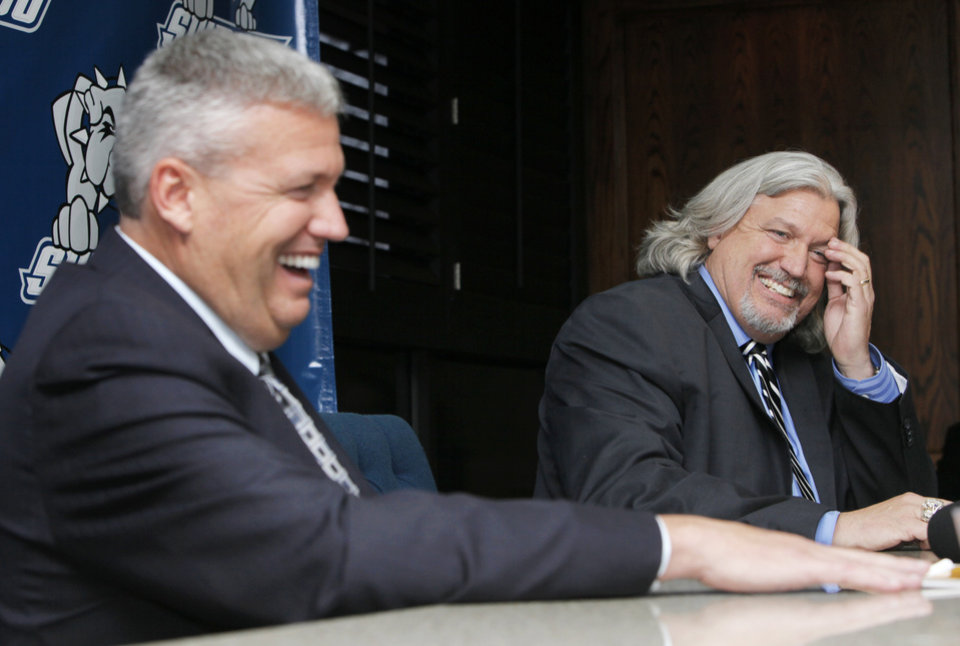Photo - Rex Ryan, left, and brother Rob Ryan laugh during a press conference before the SWOSU Athletics Hall of Fame banquet to honor the Ryan brothers at Southwestern Oklahoma State University in Weatherford, Okla., Saturday, Feb. 18, 2012. Photo by Nate Billings, The Oklahoman