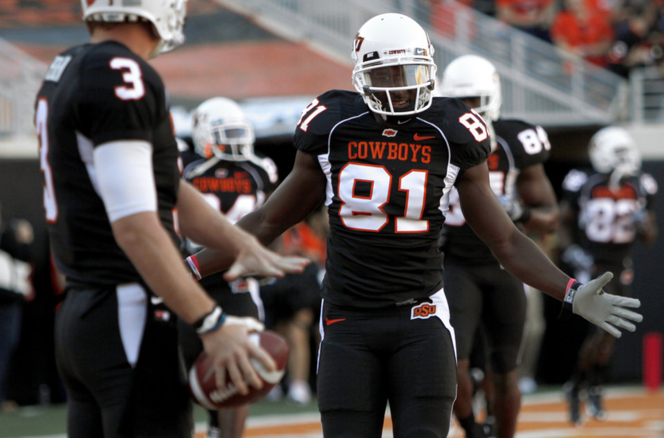 Photo - OSU's Justin Blackmon takes the field to warm up before the college football game between Texas A&M University and Oklahoma State University (OSU) at Boone Pickens Stadium in Stillwater, Okla., Thursday, Sept. 30, 2010. Photo by Bryan Terry, The Oklahoman