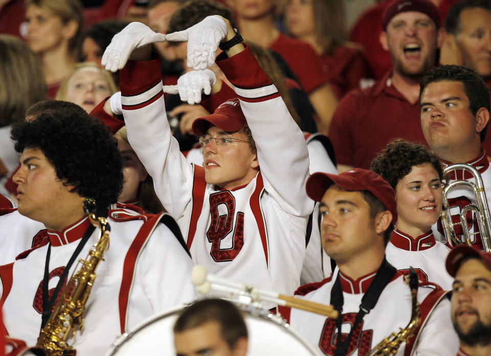 A member of the Pride of Oklahoma gives an anti-Miami sign during the college football game between the University of Oklahoma (OU) Sooners and the University of Miami (UM) Hurricanes at Land Shark Stadium in Miami Gardens, Florida, Saturday, October 3, 2009. Photo by Nate Billings, The Oklahoman