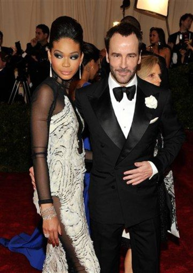 Chanel Iman and Tom Ford arrive at the Metropolitan Museum of Art Costume Institute gala benefit, celebrating Elsa Schiaparelli and Miuccia Prada, Monday, May 7, 2012 in New York. (AP Photo/Charles Sykes)