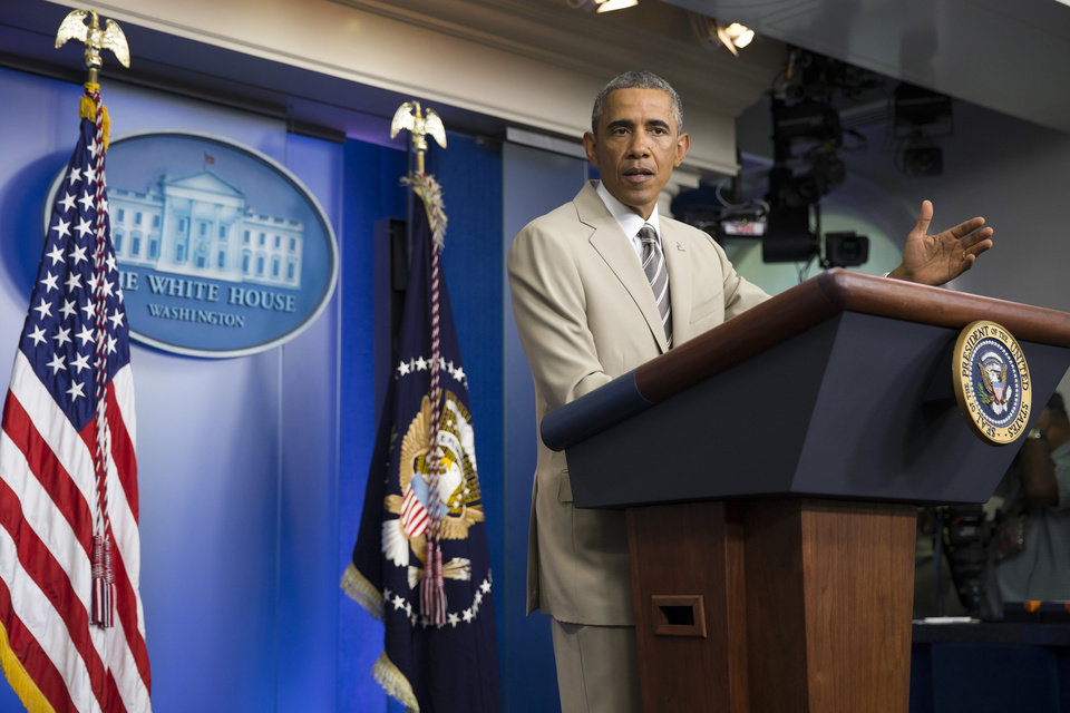 Photo - President Barack Obama gestures in the James Brady Press Briefing Room of the White House in Washington, Thursday, Aug. 28, 2014, where he spoke about the economy, Iraq, and Ukraine, before convening a meeting with his national security team on the militant threat in Syria and Iraq. (AP Photo/Evan Vucci)
