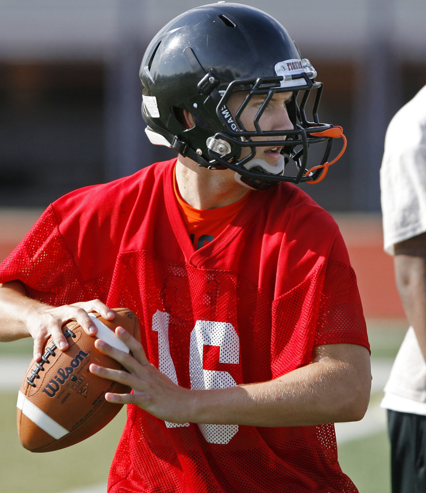 Photo - Quarterback Zach Long looks for a receiver during Norman High School Tiger football practice on Wednesday, August 10, 2011, in Norman, Okla.  Photo by Steve Sisney, The Oklahoman