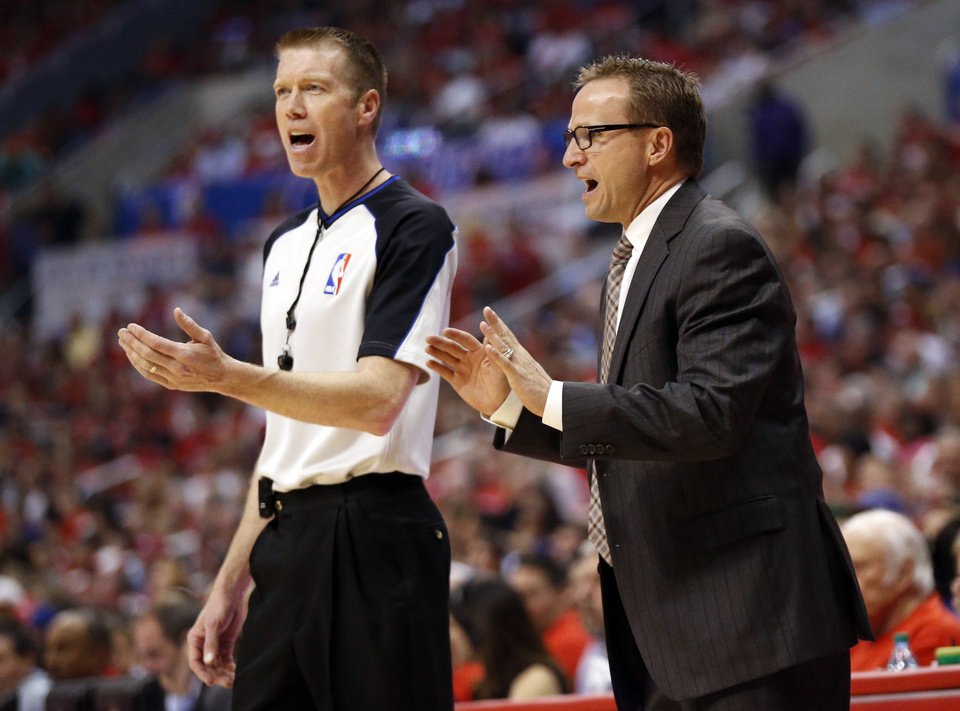 Photo - Oklahoma City's Scott Brooks reacts to a play during Game 6 of the Western Conference semifinals in the NBA playoffs between the Oklahoma City Thunder and the Los Angeles Clippers at the Staples Center in Los Angeles, Thursday, May 15, 2014. Photo by Nate Billings, The Oklahoman