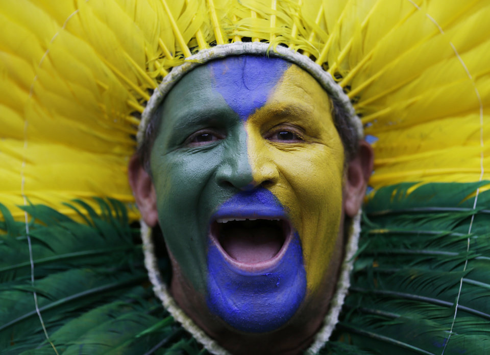 Photo - A Brazil supporter poses with his face paint before the World Cup semifinal soccer match between Brazil and Germany at the Mineirao Stadium in Belo Horizonte, Brazil, Tuesday, July 8, 2014. (AP Photo/Natacha Pisarenko)