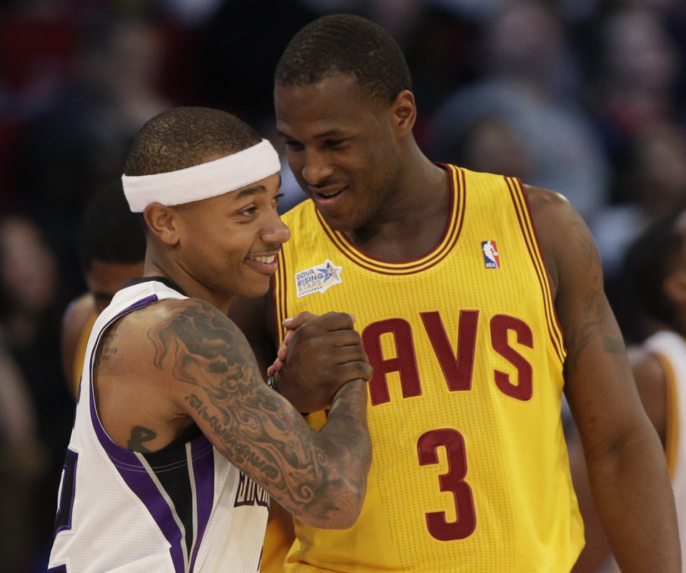 Team Chuck's Isaiah Thomas, left, of the Sacramento Kings, and Team Shaq's Dion Waiters, of the Cleveland Cavaliers, shake hands during the second half of the Rising Stars Challenge basketball game at NBA All-Star Weekend, Friday, Feb. 15, 2013, in Houston. (AP Photo/Eric Gay)